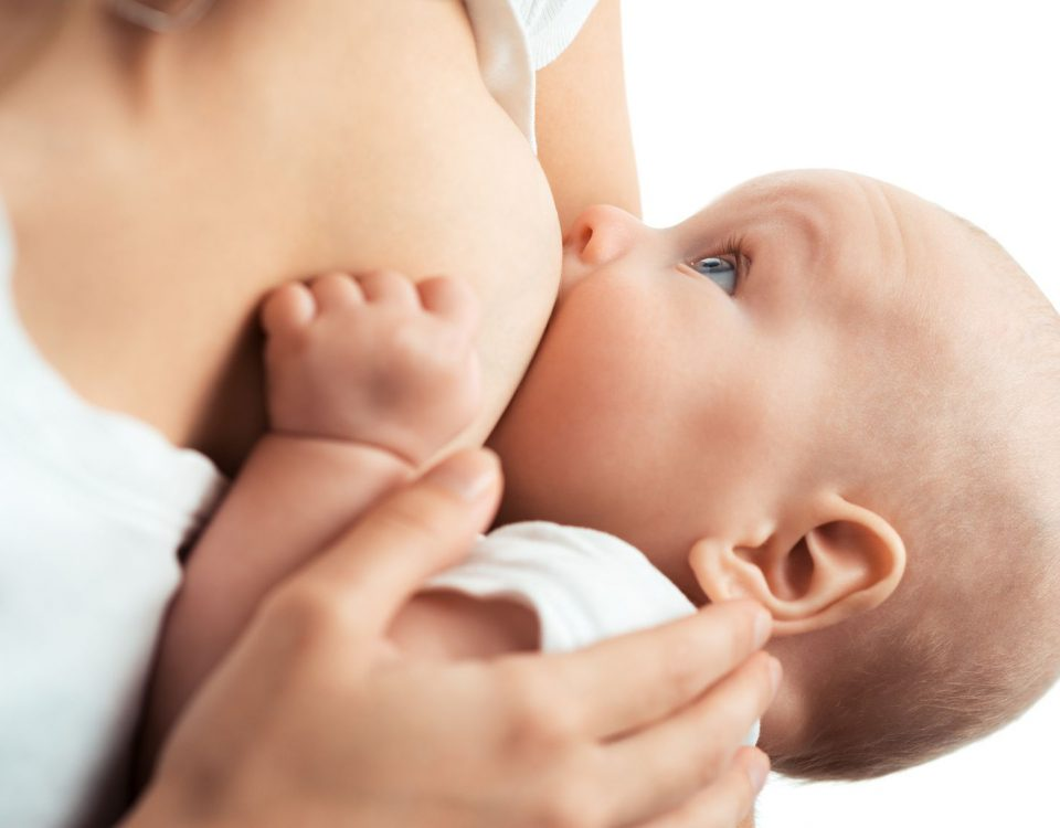 Baby feeds on MOM's breasts
